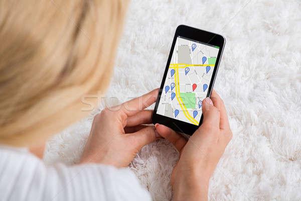 Donna GPS mappa primo piano tappeto navigazione Foto d'archivio © AndreyPopov