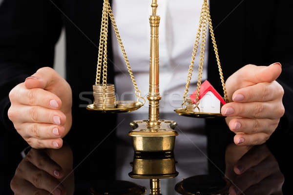 Balancing Money And House On Scales Of Justice Stock photo © AndreyPopov