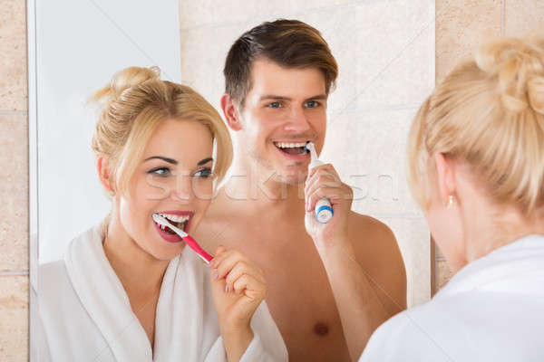 Young Couple Brushing Teeth In Bathroom Stock photo © AndreyPopov
