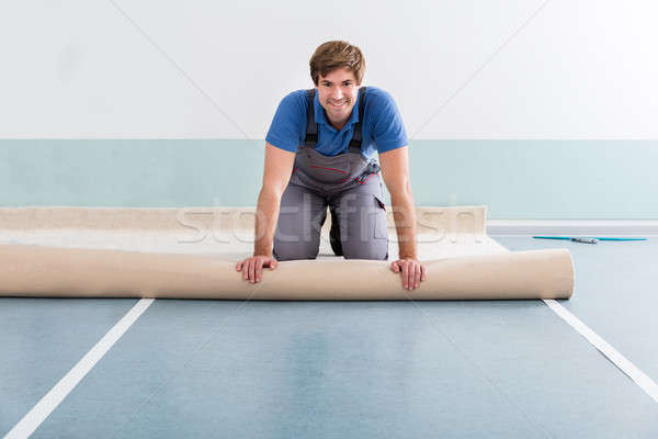Young Man Laying Carpet Stock photo © AndreyPopov