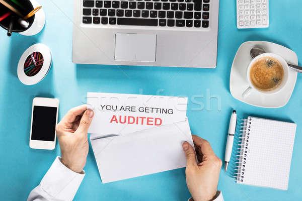 Businessman Opening Audit Letter Stock photo © AndreyPopov