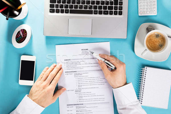 Businessman Reading Resume On Office Desk Stock photo © AndreyPopov
