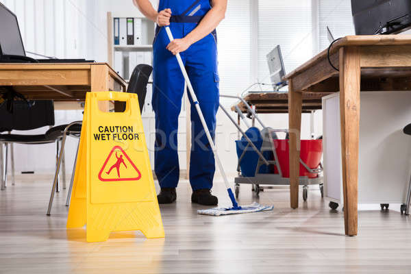 Janitor Cleaning Floor In Office Stock photo © AndreyPopov
