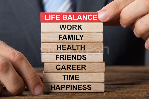 Businessman Building Life Balance Concept With Wooden Blocks Stock photo © AndreyPopov