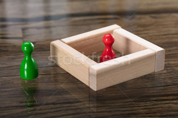 Green And Red Figurine Pawn On Desk Stock photo © AndreyPopov