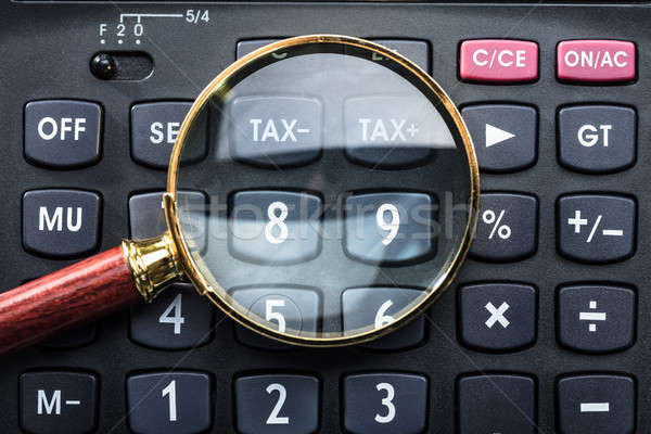 Magnifying Glass On Calculator Stock photo © AndreyPopov