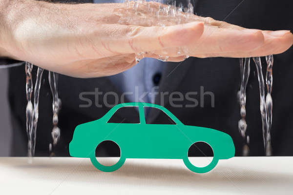 Hand Protecting The Green Car From Water Stock photo © AndreyPopov