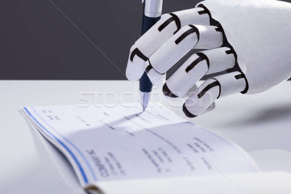 Robot Signing Cheque Stock photo © AndreyPopov