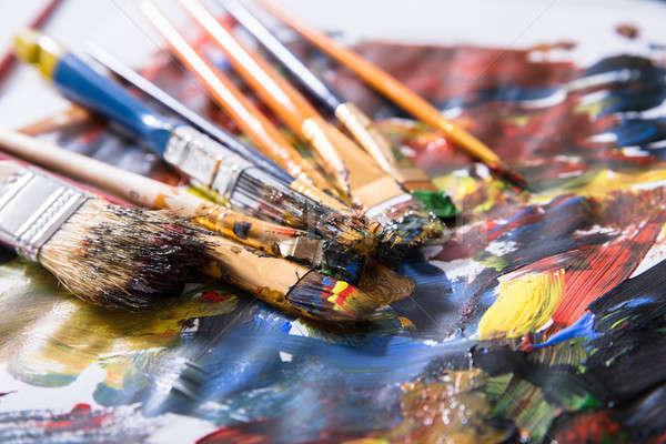 Rommelig penselen gekleurd verf Stockfoto © AndreyPopov