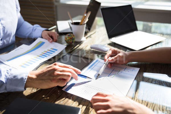 Two Businesspeople Working On Gantt Chart Stock photo © AndreyPopov