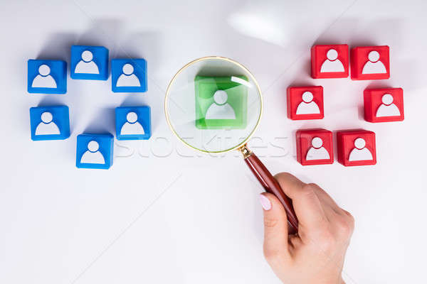 Businesswoman's Hand Holding Magnifying Glass Over Green Block Stock photo © AndreyPopov