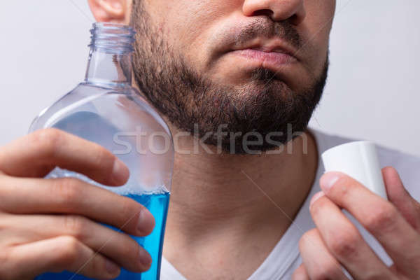 Man Rinsing His Mouth With Mouthwash Stock photo © AndreyPopov