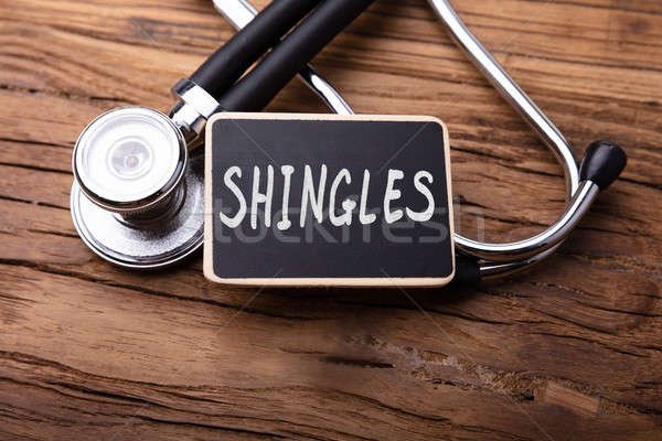 Shingles Word With Stethoscope On Wooden Table Stock photo © AndreyPopov