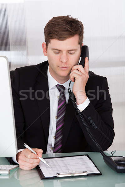 Businessman talking on telephone in office Stock photo © AndreyPopov