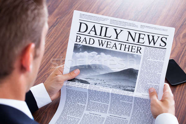 Stock photo: Close-up Of Businessman Reading Weather News