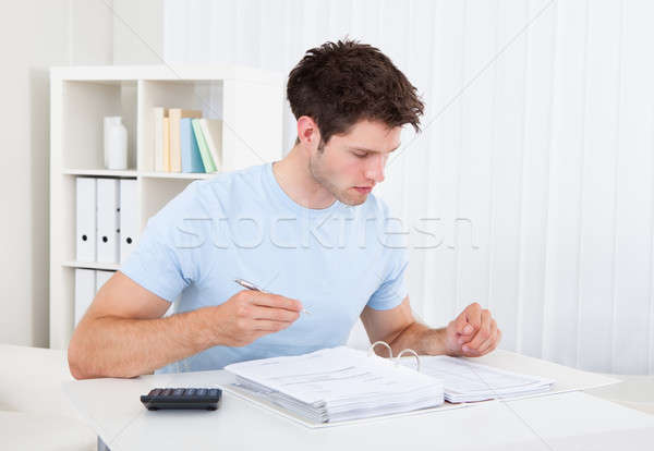 Man Calculating His Bills Stock photo © AndreyPopov