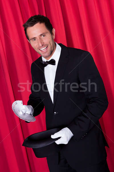 Magician Holding Fanned Deck Of Cards Stock photo © AndreyPopov