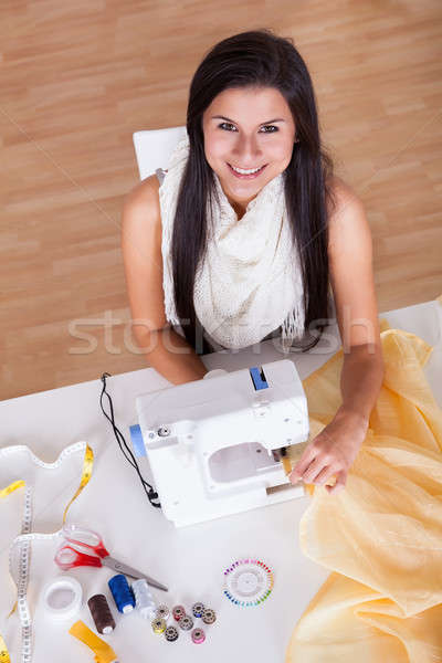Woman working with her sewing machine Stock photo © AndreyPopov
