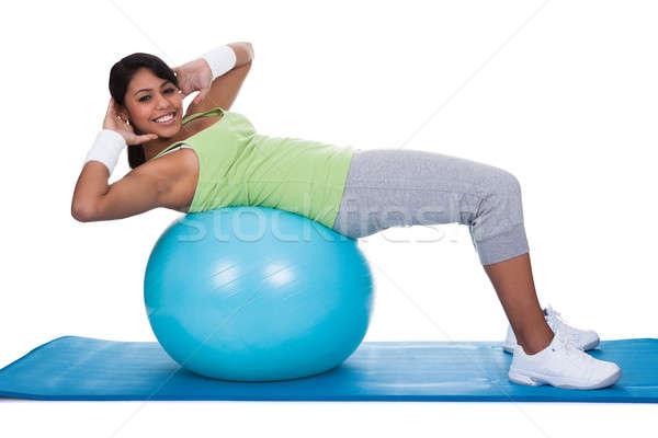 Femme pilates balle blanche fille Photo stock © AndreyPopov