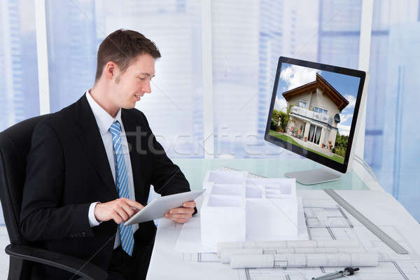 Architect Browsing Property On Computer In Office Stock photo © AndreyPopov