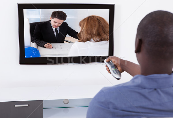 Man With Remote Watching Television Stock photo © AndreyPopov
