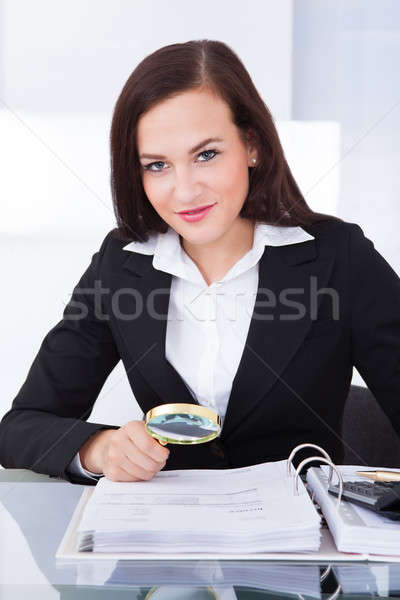 Auditor Scrutinizing Financial Documents Stock photo © AndreyPopov