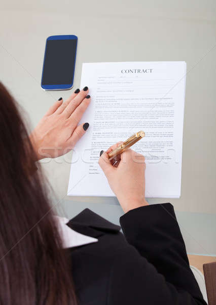 Businesswoman Signing Contract Papers Stock photo © AndreyPopov