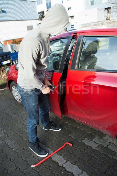 Tolvaj kapucnis kabát nyitás autók ajtó Stock fotó © AndreyPopov