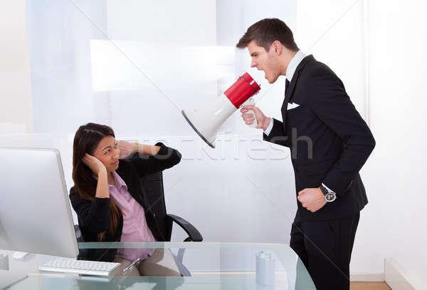 Businessman Scolding Businesswoman Stock photo © AndreyPopov