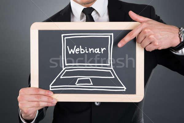Zakenman wijzend webinar teken jonge Stockfoto © AndreyPopov