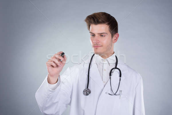 Doctor Writing On Transparent Screen Stock photo © AndreyPopov