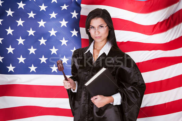 Stock photo: Female Judge With A Law Book And A Wooden Gavel