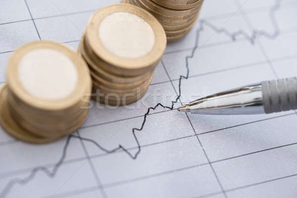 Pen With Line And Coins Graphs On Desk Stock photo © AndreyPopov