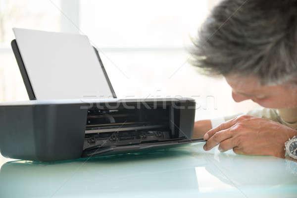Businessman Looking In Photocopy Machine Stock photo © AndreyPopov