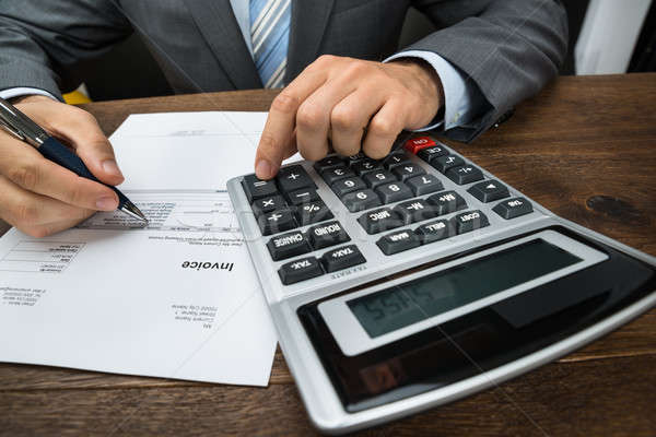 Businessperson Calculating Financial Sheet Stock photo © AndreyPopov