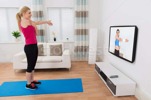 Stock photo: Woman Exercising In Living Room