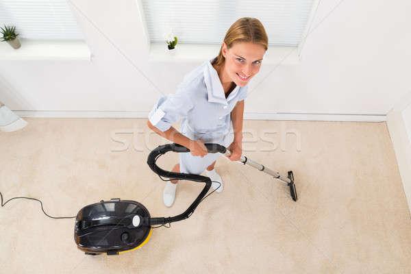 женщины горничная пылесос очистки полу Сток-фото © AndreyPopov