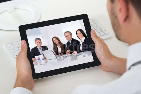 Businessman Videoconferencing With Digital Tablet Stock photo © AndreyPopov