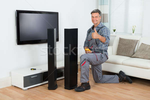 Technician Checking TV Speaker With Multimeter Stock photo © AndreyPopov