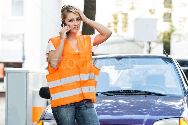 Nő mobiltelefon törött lefelé autó utca Stock fotó © AndreyPopov