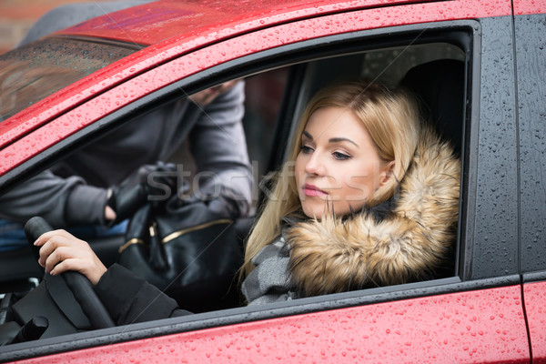 Woman Looking Away While Thief Stealing Purse From Car Stock photo © AndreyPopov