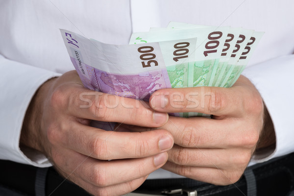 Businessman Counting Euro Banknotes Stock photo © AndreyPopov