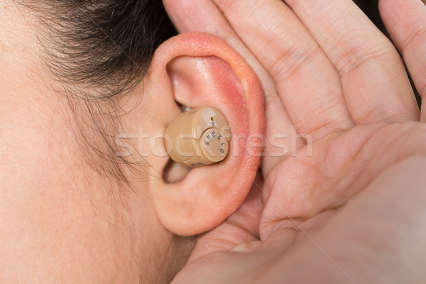 Woman Wearing Hearing Aid Stock photo © AndreyPopov