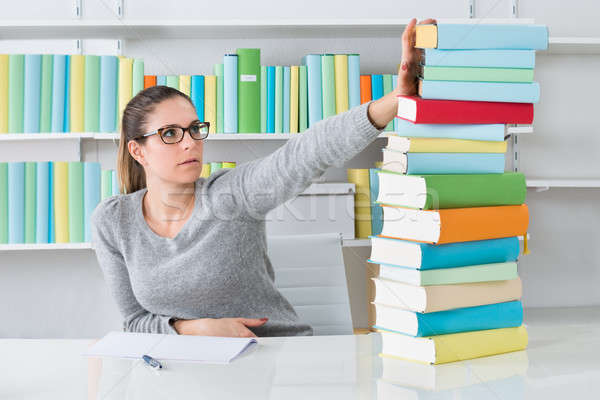 Woman Ignoring Stack Of Books Stock photo © AndreyPopov