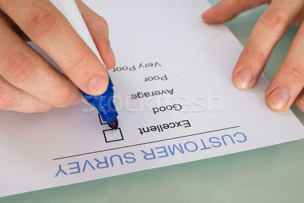 Person Hand Marking On Customer Survey Form Stock photo © AndreyPopov
