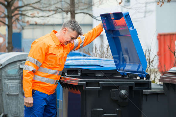 Man Looking In Dustbin On Street Stock photo © AndreyPopov