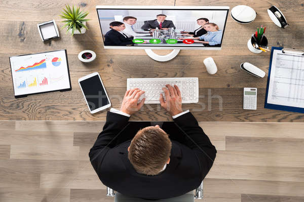 Businessman Attending Video Conference At Office Stock photo © AndreyPopov
