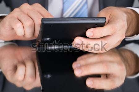 Person Measuring Blood Sugar With Glucometer Stock photo © AndreyPopov