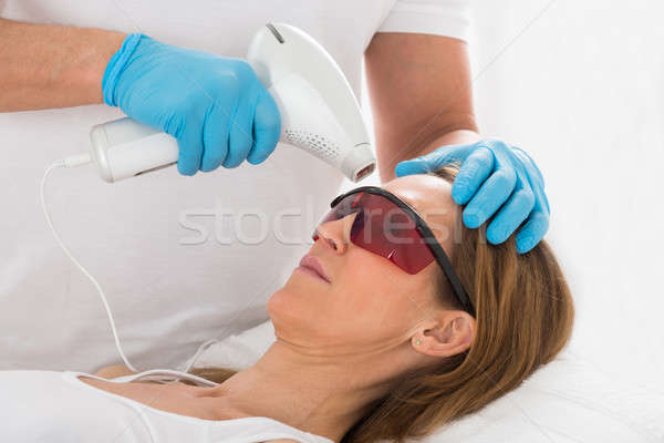 Woman Receive Laser Epilation In Beauty Clinic Stock photo © AndreyPopov