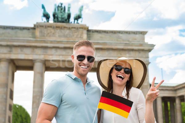 Happy Couple Holding German Flag Stock photo © AndreyPopov